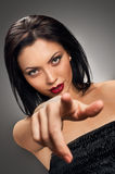 Beautiful model pointing finger Royalty Free Stock Photos