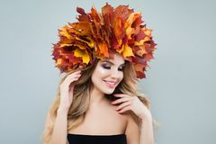 Beautiful model portrait. Autumn woman in colorful maple leaves crown.  royalty free stock photos