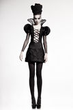 Beautiful model posing as chess queen - fashion shoot Stock Image