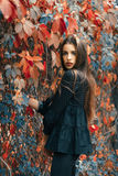 Beautiful model posing in autumn park Stock Photos
