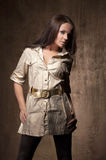 Beautiful model posing in beige coat Royalty Free Stock Image