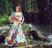 Beautiful model posing in front of a waterfall Royalty Free Stock Image