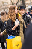 Beautiful model posing during Milan Women`s Fashion Week. MILAN, ITALY - FEBRUARY 23: Beautiful model poses outside Fendi fashion show during Milan Women`s Royalty Free Stock Image