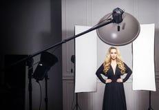 Beautiful model posing in photo studio. Royalty Free Stock Photography