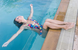 Beautiful model posing in the pool stock image