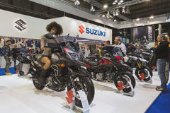 Beautiful model posing on Suzuki motorbike at EICMA 2014 in Milan, Italy Royalty Free Stock Images