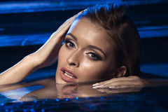 Beautiful model posing on swimming pool Royalty Free Stock Photos