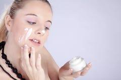 Beautiful model presents her cream Stock Image