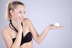 Beautiful model presents her cream Stock Photography