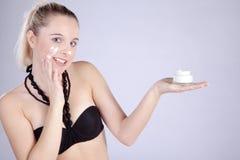 Beautiful model presents her cream Stock Images