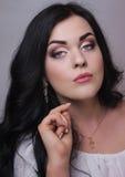 Beautiful model with professional evening make-up. Fashion model with evening professional make-up, eye make-up, make-up royalty free stock photos