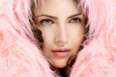 Beautiful model protect her head with a pink fur hood Stock Images
