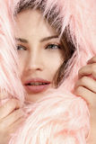 Beautiful model protect her head with a pink fur hood Royalty Free Stock Photography