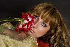 Beautiful model with a red flower Stock Photo
