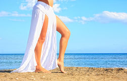 Beautiful model relaxing on a beach. Bright photo of a beautiful model relaxing on a beach Stock Photography