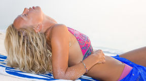 A beautiful model relaxing on a beach Stock Photography