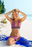A beautiful model relaxing on a beach Royalty Free Stock Image