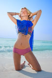 A beautiful model relaxing on a beach Royalty Free Stock Photography