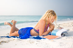 A beautiful model relaxing on the beach Royalty Free Stock Photo