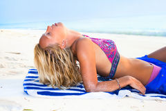 A beautiful model relaxing on a tropical beach Royalty Free Stock Photography