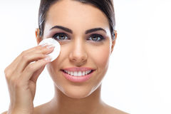 Beautiful model removing  make up. Stock Images