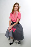 Beautiful model with rose in hair. Beautiful model wearing poodle skirt Stock Images