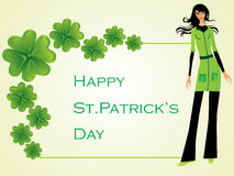 Beautiful model and shamrock clovers in the corner Stock Photography