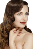 Beautiful model showing healthy brown wavy hair Stock Photos