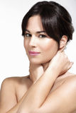 Beautiful model showing her perfect skin face Royalty Free Stock Photography