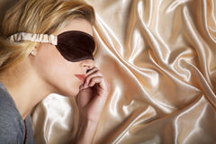 Beautiful model sleeps with blindfold Stock Images