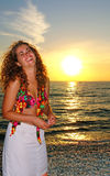 Beautiful model smiling at the beach. Happy young model keep smiling at the beautiful sunset beach Stock Photography