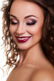 Beautiful model smiling with closed eyes professional make up Stock Image