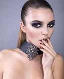 Beautiful model with smokey eyes make up Royalty Free Stock Photography
