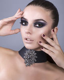 Beautiful model with smokey eyes make up Stock Photography