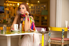 Beautiful model smoking hookah in a cafe Royalty Free Stock Photo