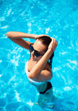 Beautiful model in a swimming pool royalty free stock images