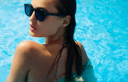 Beautiful model in a swimming pool stock images
