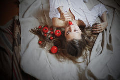 Beautiful model with tomatoes in rustic interior Royalty Free Stock Photos