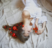 Beautiful model with tomatoes in rustic interior Royalty Free Stock Image