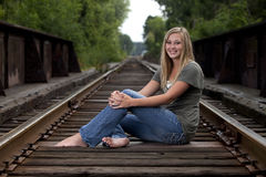 Beautiful model on train tracks Stock Photo