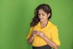 Beautiful model using mobile phone Stock Image