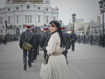 Beautiful model walks the city in a  white dress Stock Image