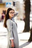 Beautiful model walks in europian city. Royalty Free Stock Photography