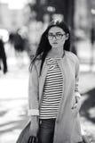 Beautiful model walks in europian city. Royalty Free Stock Images