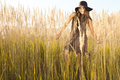 Beautiful model wandering through meadow wilds at midday Royalty Free Stock Photo