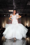 Beautiful model wear wedding dress walks catwalk Royalty Free Stock Photos