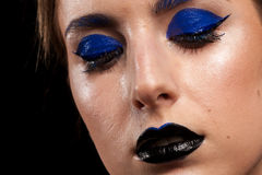 Beautiful model wearing blue make up with black lips Stock Images