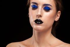 Beautiful model wearing blue make up with black lips Royalty Free Stock Photo