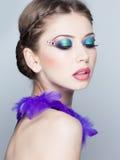 Beautiful model wearing blue make-up - studio shot on grey Royalty Free Stock Images