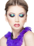 Beautiful model wearing blue make-up - studio shot on white Stock Photography